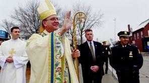 Bishop John Barres greets parishioners outside Saint Agnes