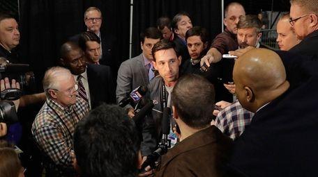 Atlanta Falcons offensive coordinator Kyle Shanahan speaks with