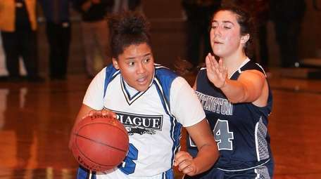 Copiague's Tayanee Peay (3) drives to the basket