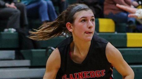Lauren Krystall of Plainedge drives to the basket