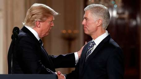 President Donald Trump shakes hands with Appeals Court