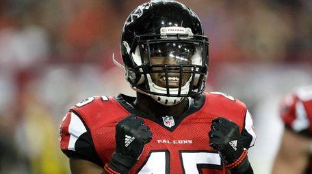 Falcons middle linebacker Deion Jones walks off field