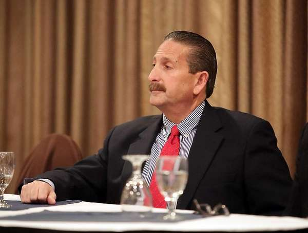 Longtime athletic director Pete Blieberg during the Suffolk