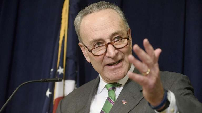 Sen. Charles Schumer answers questions during a news