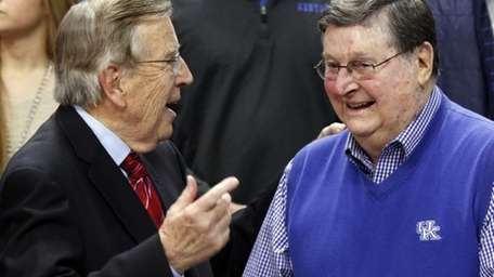 Veteran broadcaster Brent Musburger, left, chats with former