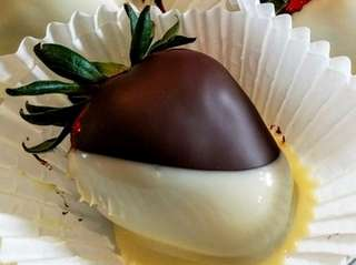 Strawberries dipped in chocolate -- dark, milk or