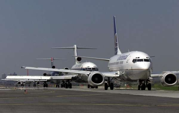 Planes line up for takeoff at LaGuardia Airport,