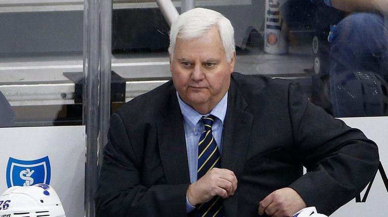 St. Louis Blues coach Ken Hitchcock stands behind