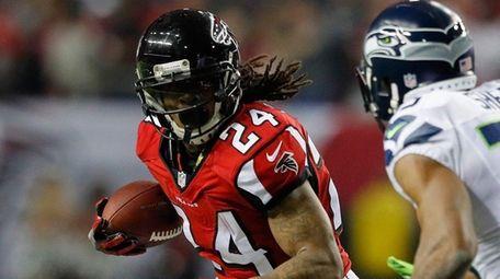Devonta Freeman of the Falcons runs against the