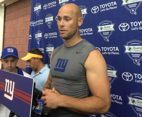Josh Brown speaks with reporters at Giants training