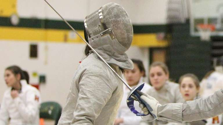 Ward Melville's Bridget Becchina, left, fences Half Hollow