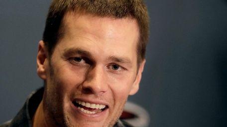 New England Patriots quarterback Tom Brady talks to