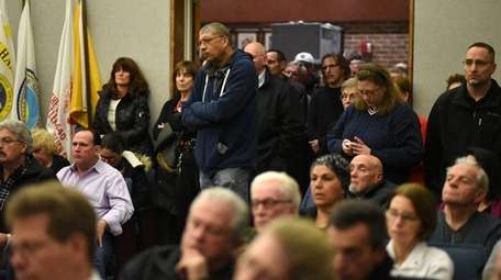People crowd a public hearing on a controversial