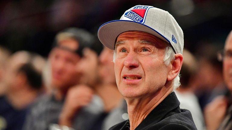 Former tennis player John McEnroe looks on during