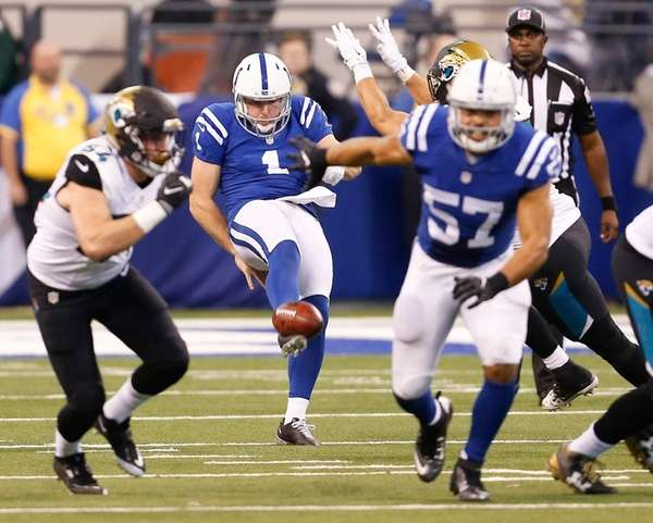 Indianapolis Colts punter Pat McAfee punts as Jacksonville