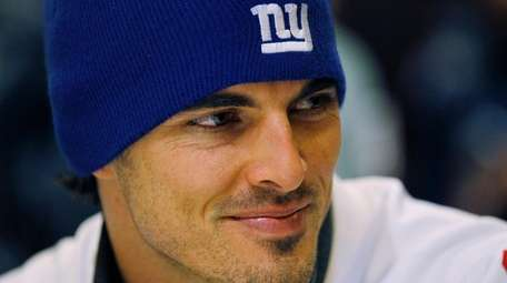New York Giants' David Carr answers questions during