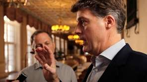 New York Yankees owner Hal Steinbrenner talks with