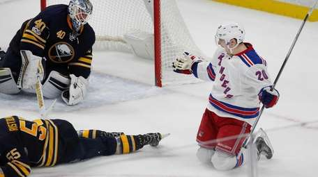 New York Rangers forward Chris Kreider (20) puts