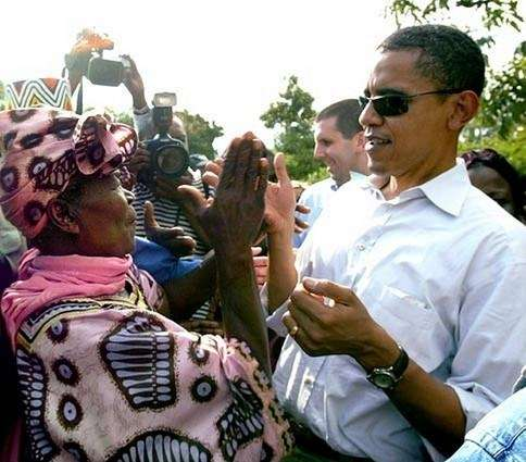 Barack Obama claps hands with his grandmother, Sarah