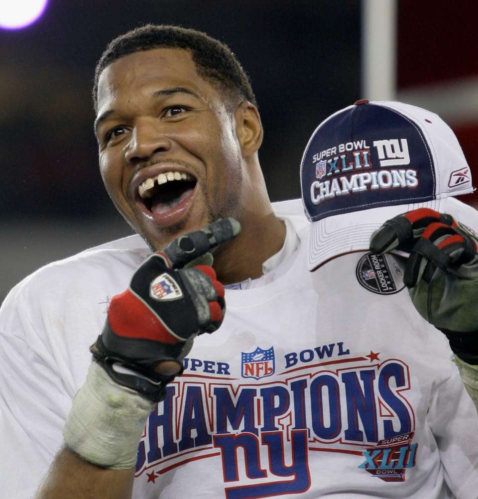 New York Giants defensive end Michael Strahan celebrates