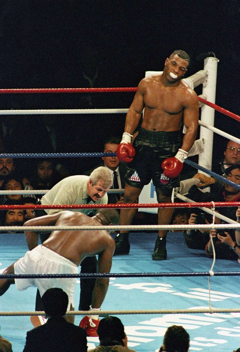 Champion Mike Tyson stands in a neutral corner