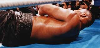 Referee Octavio Mayron counts as champion Mike Tyson