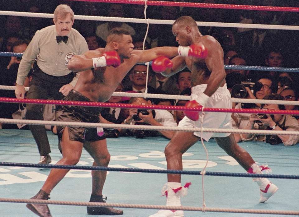Heavyweight boxers Mike Tyson, left, and James