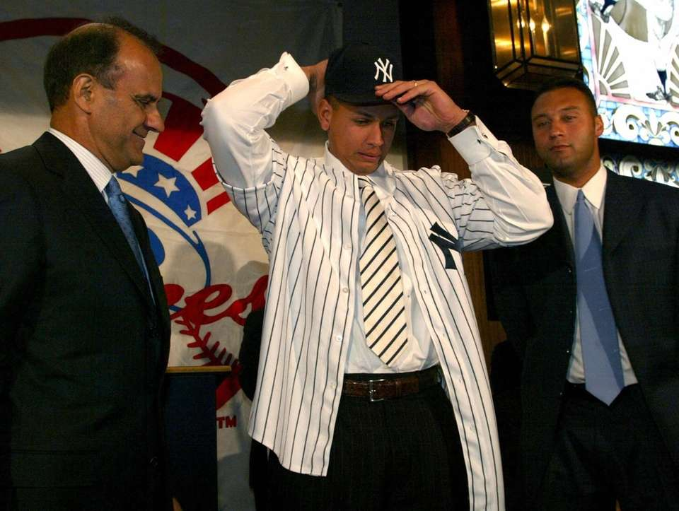 Alex Rodriguez tries on his new Yankees cap