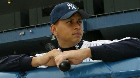 Alex Rodriguez poses in Yankee Stadium the day