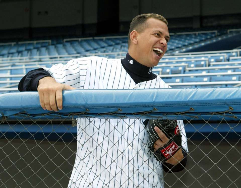 Alex Rodriguez laughs during a photo shoot in