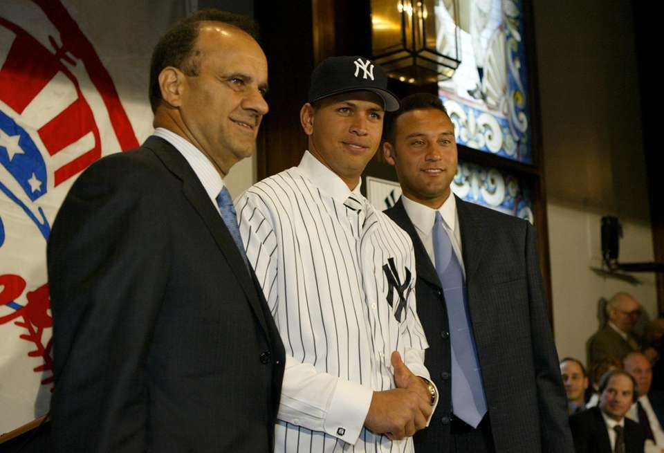 From left, Yankees manager Joe Torre, new third