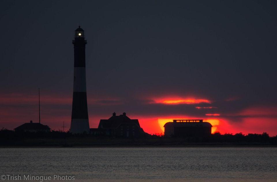 Sunrise behind Fire Island Lighthouse