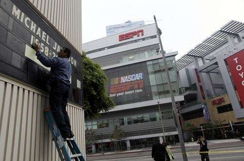Rudy Ocegueda places letters on a marquee in