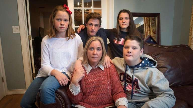 Christine McKenna, center, with her four children, from