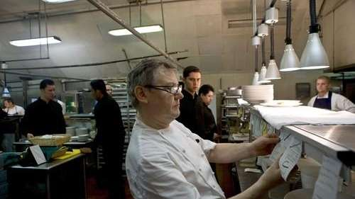 Chef Guy Reuge reads an order in the