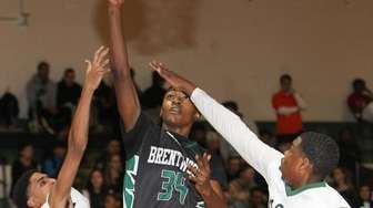 Brentwood's Bryce Harris (34) puts one up while