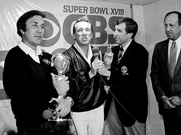 Oakland Raiders coach Tom Flores clutches the