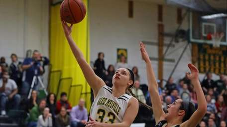 Bre Cohn (33) of Ward Melville goes up