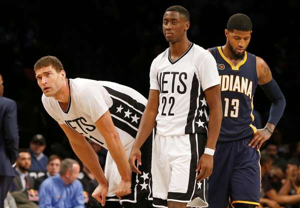 Brook Lopez (11) and Caris LeVert (22) of