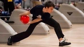 Hewlett's John Paul West bowls at the Nassau