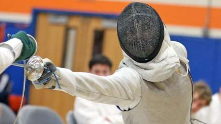 Garden City's Philip Acinapuro in the boys foil