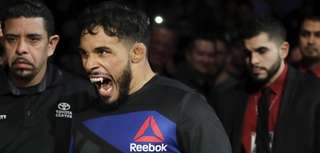 Dennis Bermudez enters the octagon to face Chan