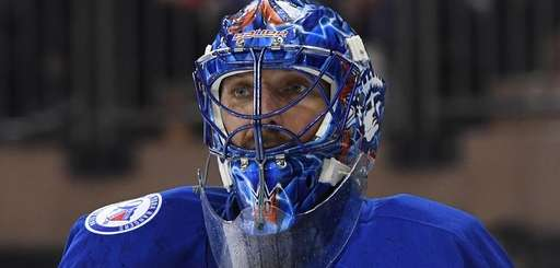 New York Rangers goalie Henrik Lundqvist looks on