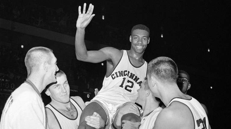 Jubilant Cincinnati forward Oscar Robertson is carried by