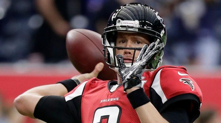 Atlanta Falcons quarterback Matt Ryan warms up before