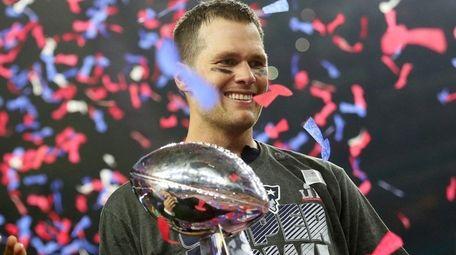 Tom Brady of the New England Patriots holds