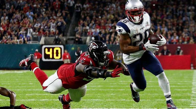 New England Patriots running back James White outruns