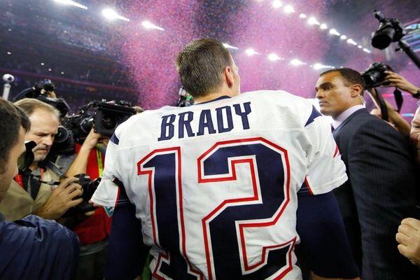 Tom Brady makes his way through the media