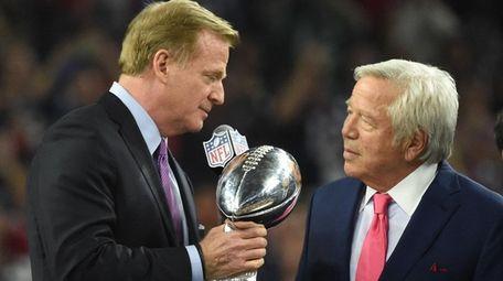 NFL commissioner Roger Goodell hands the Lombardi Trophy