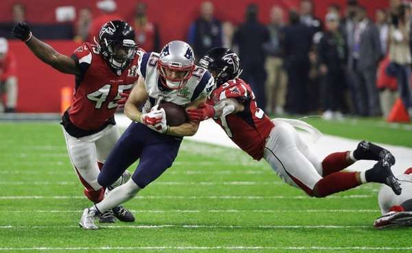 New England Patriots' Chris Hogan runs between Atlanta